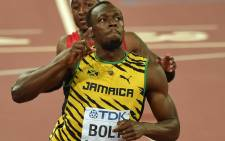 FILE: Jamaica's Usain Bolt celebrates winning the final of the men's 100 metres athletics event at the 2015 IAAF World Championships at the Bird's Nest National Stadium in Beijing on 23 August 2015. Picture: AFP.