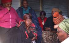 Family members of the six who were killed in the shack fire sit in shock after finding out what happened. Picture: Bertram Malgas