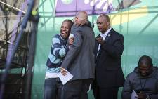 President Jacob Zuma hugs Colin Chauke, a man from Orange Farm, after having given him money during Youth Day celebrations at Orlando stadium in Soweto on 16 June 2016. Picture: Reinart Toerien/EWN.