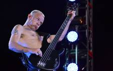Red Hot Chili Peppers bassist Flea on stage at Cape Town Stadium on 5 February 2013. Picture: Aletta Gardner/EWN
