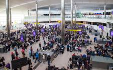 Hundreds of passengers at Heathrow International Airport in London waiting in long queues to board their flights. Picture: Facebook.
