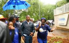 Democratic Alliance leader Mmusi Maimane outside the Gupta compound in Saxonworld, Johannesburg. Picture: EWN.