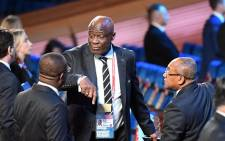 In this file photo taken on 1 December 2017 FIFA council member Constant Omari Selemani (C) speaks with guests ahead of the 2018 FIFA World Cup football tournament final draw at the State Kremlin Palace in Moscow. Picture: AFP