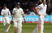 Sachin Tendulkar (C) walks off the pitch after losing his wicket to England's James Anderson (R) during day five, the last day, of the 1st test match on July 25, 2011. Picture: AFP