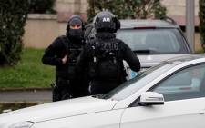 RAID police unit officers investigate at the house of the suspect of an attack at the Paris Orly's airport, on 18 March, 2017 in Garges-les-Gonesse. Picture: AFP.