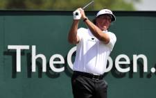 US golfer Phil Mickelson tees off on the first during the fourth and final round of the 2013 British Open Golf Championship at Muirfield golf course at Gullane in Scotland on 21 July 2013. Picture: AFP/GLYN KIRK