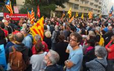 Some 500 people, some holding the Catalan flag, demonstrate outside the Spanish Consulate in Perpignan on 2 October 2017 to protest against police violence during a banned independence referendum in the Catalan region in Spain. Picture: AFP