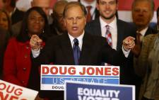Democratic US Senator-elect Doug Jones speaks to supporters during his election night gathering the Sheraton Hotel on December 12, 2017 in Birmingham, Alabama. Picture: AFP.