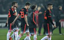 Manchester United players leave the pitch after the Uefa Europa League soccer match between FC Midtjylland and Manchester United in Herning, Denmark, 18 February 2016. Manchester lost the match 1-2. EPA/HENNING BAGGER