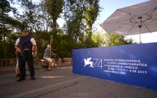 Local police control the entrance of the 74th Venice Film Festival on August 29, 2017 at Venice Lido. Picture: AFP.