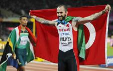 Turkey's Ramil Guliyev celebrates after winning the final of the men's 200m athletics event at the 2017 IAAF World Championships at the London Stadium in London on 10 August 2017. Picture: AFP