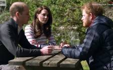 A screen grab of Prince William, his wife, Kate, and Prince Harry. Picture: CNN.