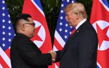 North Korea's leader Kim Jong Un shakes hands with US President Donald Trump at the start of their historic US-North Korea summit at the Capella Hotel on Sentosa island in Singapore on 12 June 2018. Picture: AFP.