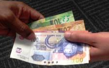 The rand climbed to a session high of 12,0840 to the greenback, its strongest since 28 May, and was up 0,56 percent at 12,1110 by 1502 GMT compared with Friday's close. Picture: Reinart Toerien/EWN.