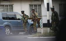 Zimbabwean soldiers control vehicle access at an intersection in Harare on 15 November 2017. Picture: AFP.