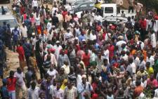FILE: Supporters mass to see veteran rebel leader Agathon Rwasa in Bujumbura on 6 August 6, 2013. Rwasa returned to the capital of Burundi after three years in exile.  Picture: AFP.