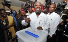 FILE: Former Ivory Coast President Laurent Gbagbo casts his vote on October 31, 2010 at a polling station in Abidjan. Picture: AFP