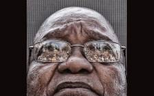 The crowd who gathered to support former President Jacob Zuma is seen reflected in his glasses as he waits to speak after appearing on corruption charges at the Durban High Court on 6 April 2018. Picture: Ihsaan Haffejee/EWN.
