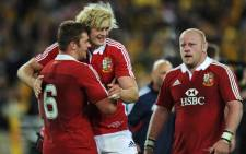 Players from the British and Irish Lions celebrate a win. Picture: AFP