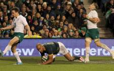 South Africa's JP Pietersen (C) scores a try during the Autumn International rugby union Test match between Ireland and South Africa at the Aviva Stadium in Dublin, Ireland, on 8 November, 2014. Picture: AFP.