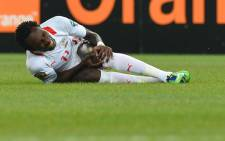 FILE: Burkina Faso's midfielder Jonathan Pitroipa holds his knee after sustaining an injury during an Africa Cup of Nations match. Picture: AFP