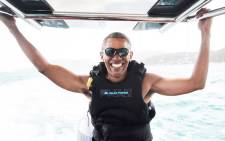 Former US president Barack Obama kiteboarding on a Caribbean island. Picture: virgin.com/richard-branson