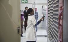 A patient collects her chronic medication from an Pharmacy Dispensing Unit in Alex which works like an ATM pharmacy. Picture: IHSAAN HAFFEJEE/EWN