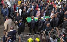 The scenes outside the home of Winnie Madikizela-Mandela as her body returns home in a coffin draped in the colours of the ANC ahead of her funeral on Friday 14 April 2018. Picture: Ihsaan Haffejee/EWN