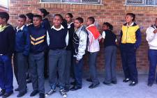 Learners at ACJ Phakade had class while sitting on the floor as the school had no desks or chairs.