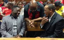 Irvin Jim shares a moment with Sdumo Dlamini inside South Gauteng High court. Picture: Sebabatso Mosamo/EWN