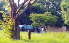 A screenshot of a video showing an attempted hijacking in Rubenstein Drive, Moreleta Park.