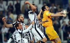 Juventus players celebrate after beating Real Madrid in the first leg of the Uefa Champions League semifinal in Turin, Italy on 5 May 2015. Picture: Uefa Champions League.