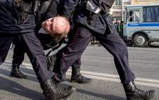 FILE: Police officers detain a man during an unauthorised anti-corruption rally in central Moscow on 26 March, 2017. Picture: AFP.
