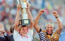 FILE: South African President Nelson Mandela celebrates with the national squad captain Neil Tovey, holding the trophy, on 3 February, 1996 after South Africa beat Tunisia 2-0 during the Africa Nations Cup soccer final in Johannesburg. Picture: AFP.