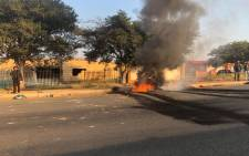 Debris burns in a Soweto road during service delivery protests on 2 May 2018. Picture: Mia Lindeque/EWN