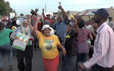 Residents in Cyril Ramaphosa's old neighbourhood in Chiawelo, Soweto celebrate him being elected as the new ANC president. Picture: Louise McAuliffe/EWN