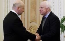 Ukrainian parliament speaker and interim president Olexander Turchynov (L) greets United States Senator John McCain prior to talks in Kiev on 14 March 2014. Picture: AFP.