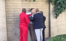A screengrab shows Media24's Adrian de Kock being assaulted by EFF deputy president Floyd Shivambu on Tuesday 20 March 2018. Picture: @JasonFelix/Twitter