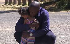 DA parliamentary leader Mmusi Maimane hugs a child in Eldorado park south of Johannesburg on 8 September 2014. Picture: Reinart Toerien/EWN