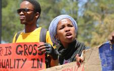 A female student pleads with her peers not to throw rocks at police during a protest at the Union Buildings in Pretoria on 23 October 2015. Picture: Reinart Toerien/EWN.