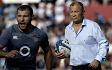 England's head coach Eddie Jones (R) gestures next to scrum-half Danny Care during the warm-up before their Rugby Union test match against Argentina at Brigadier General Estanislao Lopez stadium in Santa Fe, Argentina on 17 June 2017. Picture: AFP