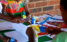 Children painting. Picture: Ikageng Itireleng Aids Ministry.