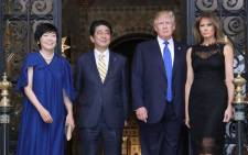 FILE: US President Donald Trump (centre R), Japan's Prime Minister Shinzo Abe (centre L), Trump's wife Melania (R) and Abe's wife Akie (L) pose for photograpers before a dinner party in Palm Beach, Florida on 11 February 2017. Picture: AFP