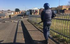 Police are firing rubber bullets and using teargas on protesters in Diepkloof Soweto as they clear several roads leading into the area on 24 May 2017. Picture: Mia Lindeque/EWN