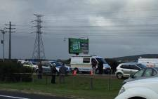 Police and forensic experts at the scene where a police officer was stabbed to death in an attack on the N2 highway. Picture: Natalie Malgas/EWN