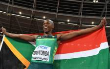 Gold medallist South Africa's Luvo Manyonga celebrates after the final of the men's long jump athletics event at the 2017 IAAF World Championships at the London Stadium in London on 5 August, 2017. Picture: AFP.