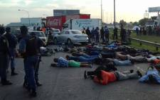 Johannesburg authorities make arrests following a blockade on the R21 and R24 highway near the OR Tambo International Airport on 27 October 2017. Picture: @EWNTraffic/Twitter