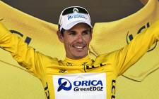 Daryl Impey celebrates his yellow jersey at the end of the sixth stage of the 100th edition of the Tour de France cycling race. Picture: AFP.