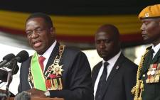 Zimbabwean new interim President Emmerson Mnangagwa (L) gives an address after he is officially sworn-in during a ceremony in Harare on 24 November 2017. Picture: AFP.