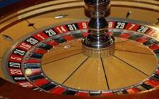 The hotels and casino operator was helped by an acquisition that offset slow revenue in SA.